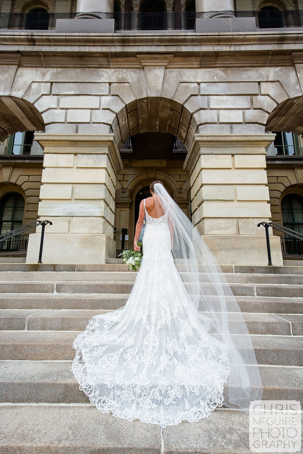 Bride in dress and veil at Illinois State Capitol in Springfield