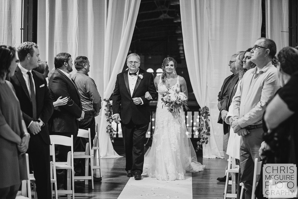 Bride and father walk down the aisle at Illinois State Fairgrounds Wedding