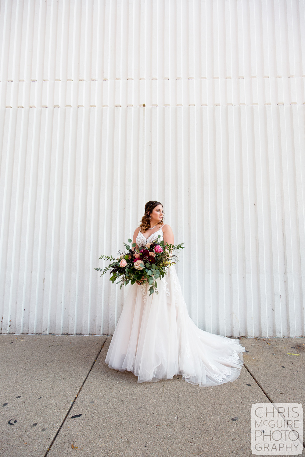 Bride with white wall in Peoria IL