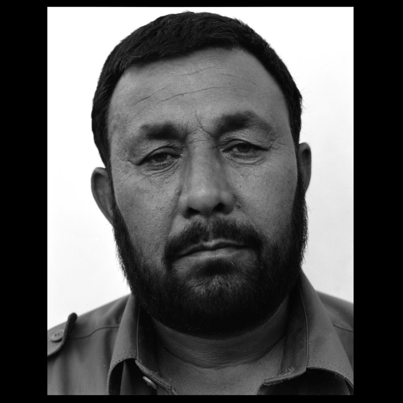 An Afghan police officer in Marja.