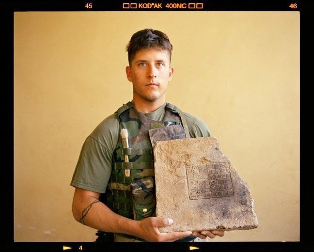 Lance Cpl. Troy Merrell, Echo Company, Second Battalion, 25th Marines with recovered Sumerian tablet in Shatra, Iraq. June 22, 2003.