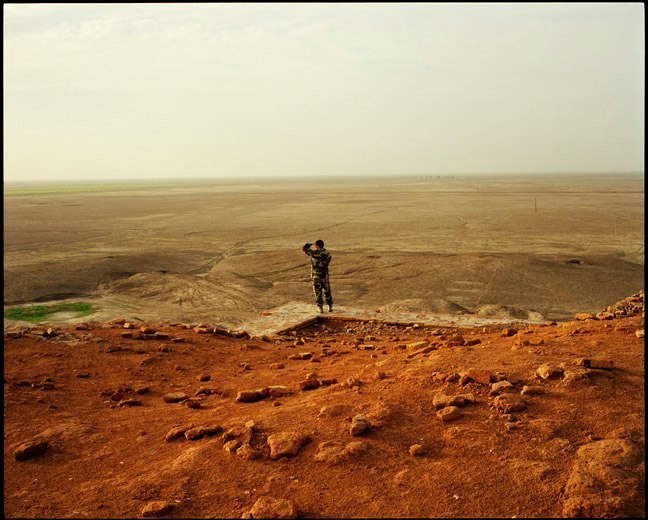 Italian soldier looks out across Mesopotamian plain from on top the Ziggurat at Ur. July, 2004.