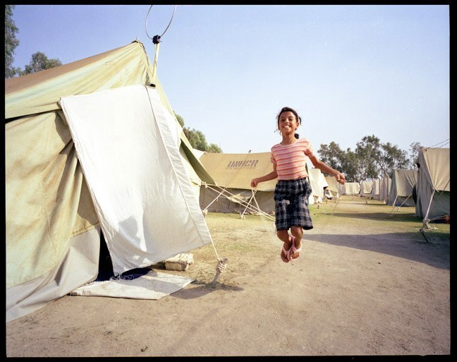 Palestinian girl skips rope at UNHCR camp in Baghdad. June, 2003.