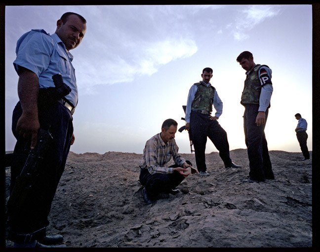 Abdul Amir Hamdani with Iraqi police inspecting looted archaeological site. May, 2004.
