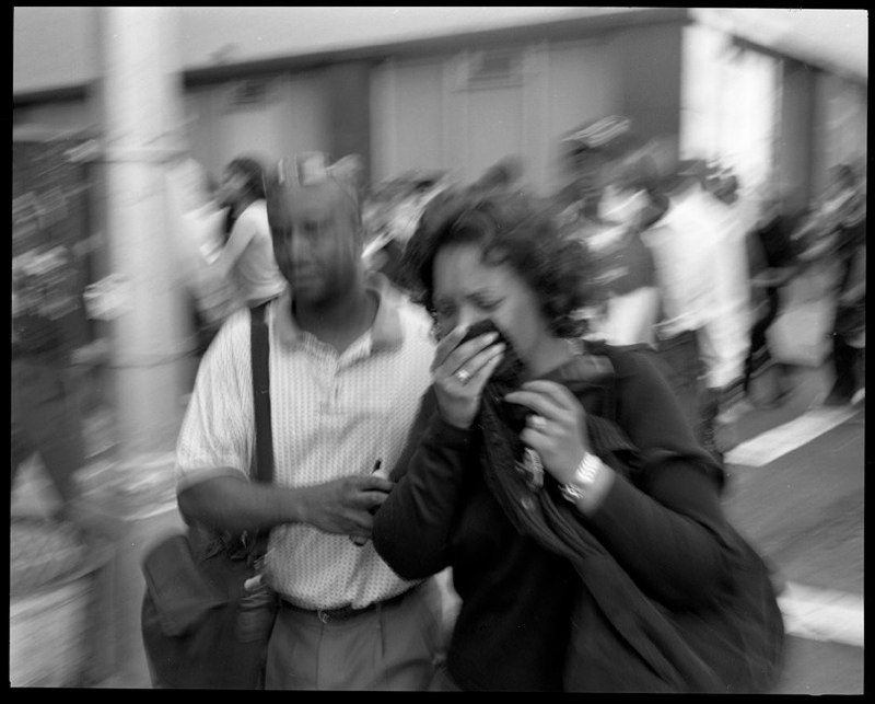 Woman is led away from the collapse of the World Trade Center towers in lower Manhattan, September 11, 2001.