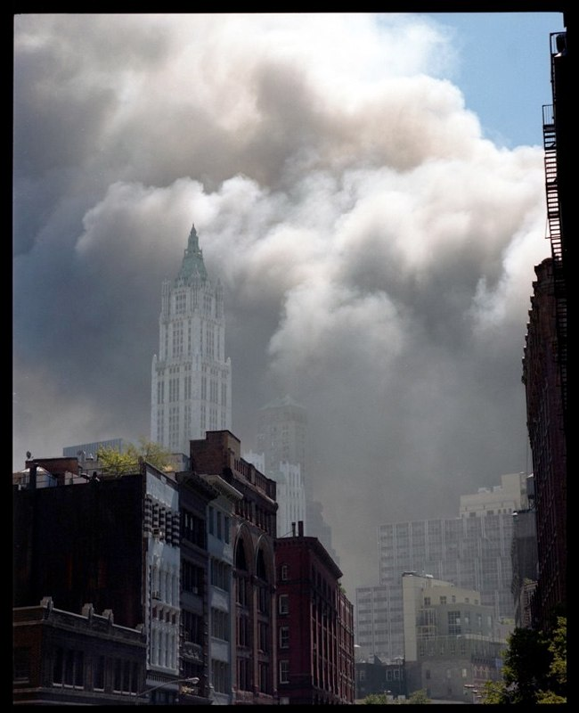 Cloud of dust over the Woolworth building in lower Manhattan after the collapse of the two World Trade Center buildings, September 11, 2001.