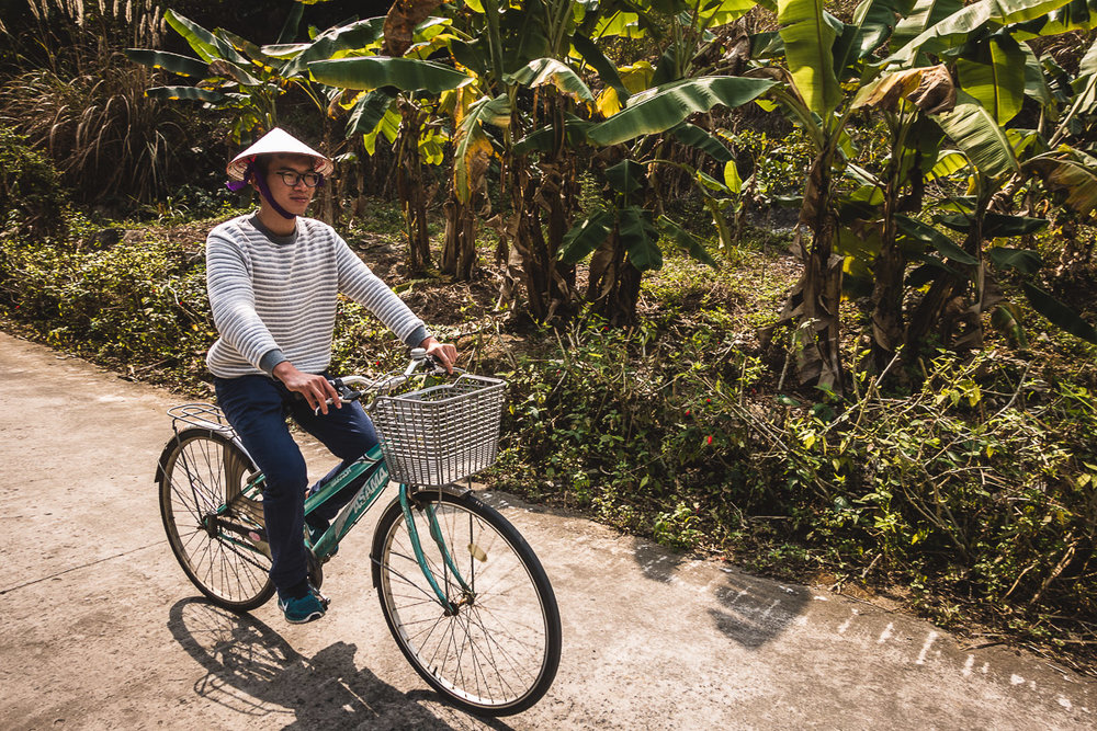 Our guide Koo riding the bike on Cat Ba Island.