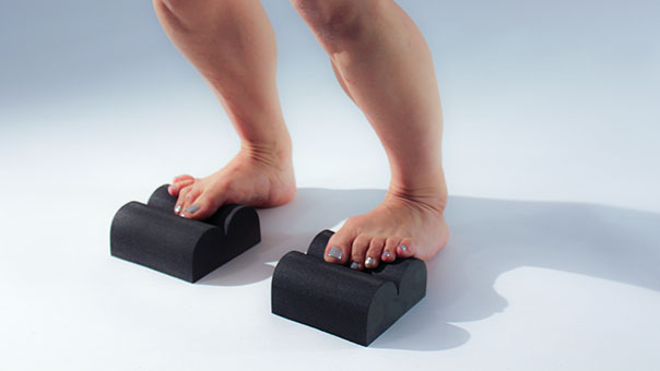 1. STRETCH   Place the balls of the feet on the MINIS™ so the toes relax into the Center Channel. Feel the upper calf lengthen as you stand with knees straight. After a few seconds, soften the knees to release the upper calf muscles. Repeat for a minute daily and avoid low back and heel pain (plantar fascitis).