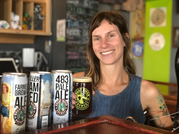 Wedny Saathoff poses with some of Great River Brewery's best brews.