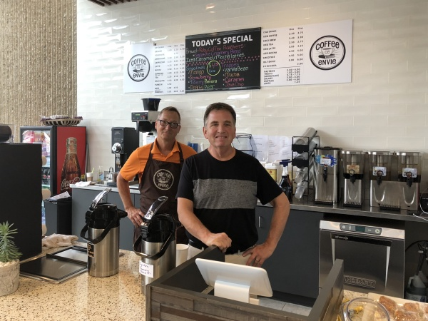 Steve (right) and one of his employees, Dean, at Coffee Envie.