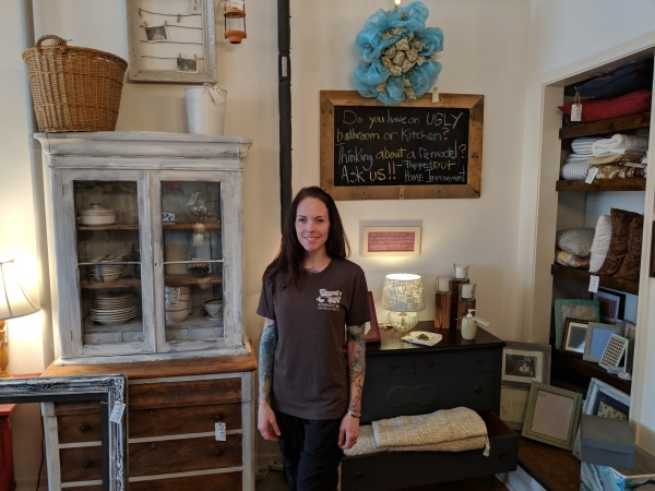 Rebekah surrounded by some of the many wares in her store.