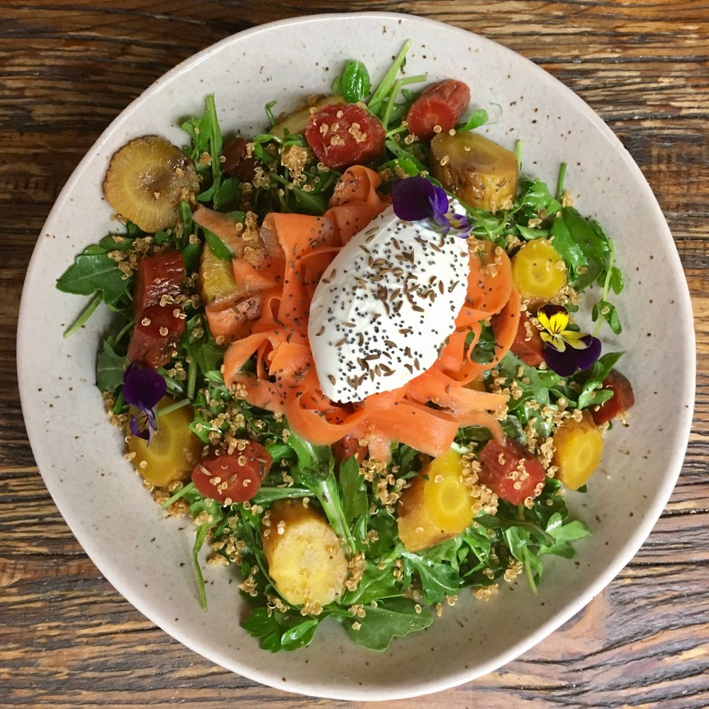 Arugula salad with roasted & pickled carrots, toasted caraway & poppy seeds, crispy quiona, champagne vinaigrette and house made creme fraiche