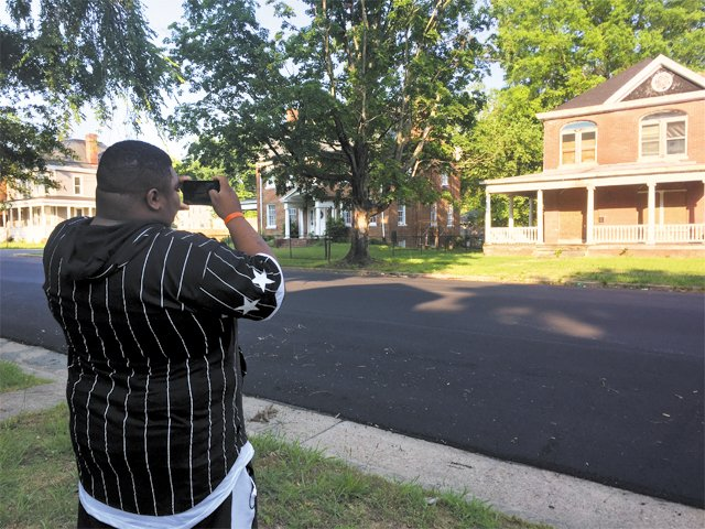 "Field Study - Jonathan Scott, a 2017 John Marshall High School graduate, photographs an empty house. It's a shame it's not being used, he says. ""Some people don't have homes."""