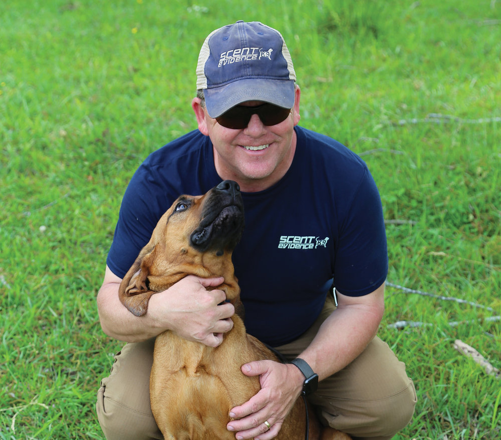 Paul Coley, creator of Scent Evidence K9, poses with his dog, Nancy Drew. Photo courtesy Scent Evidence K9