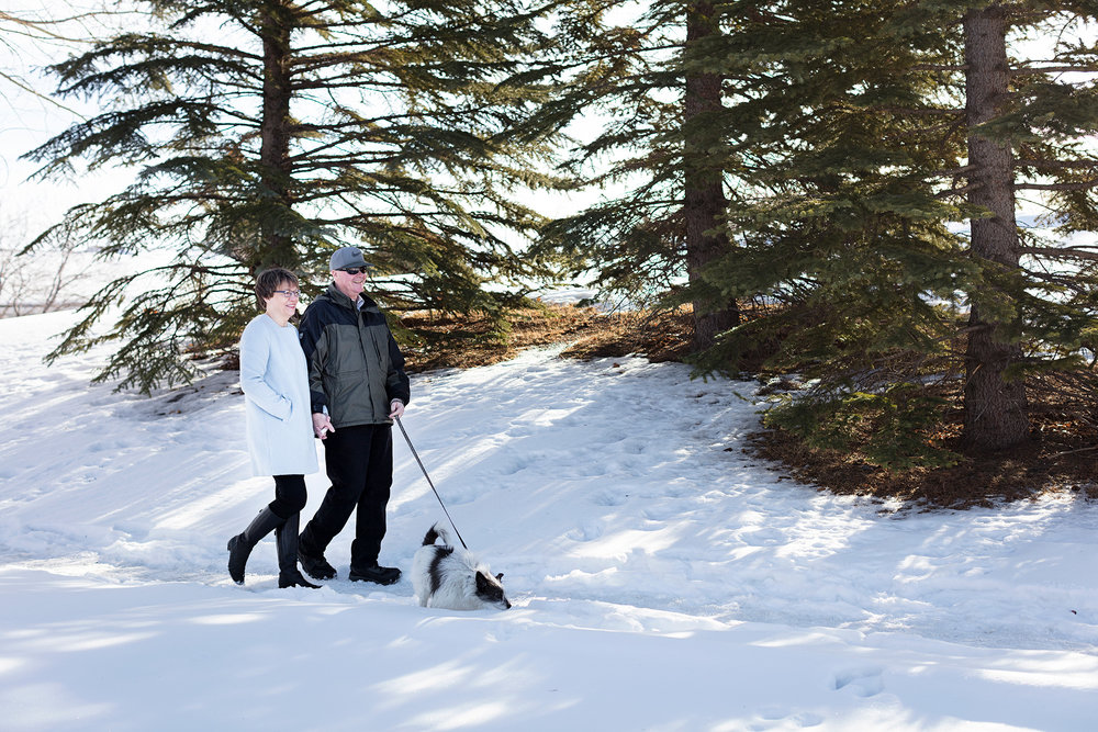 John and Cindy McCaffery enjoy a winter walk with their dog, Scruffy. John was diagnosed with young onset dementia at the age of 48. photo by Erin Brooke Burns