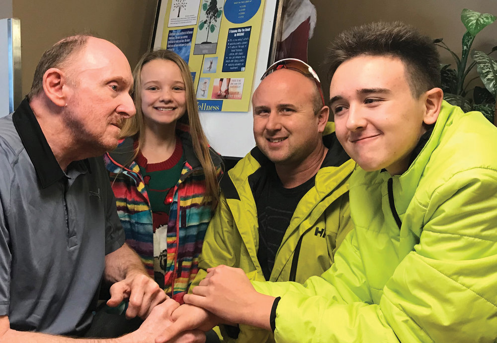 Clarence Travis visits with his family at Villa Caritas in Edmonton. Pvhoto courtesy of Bernie Travis