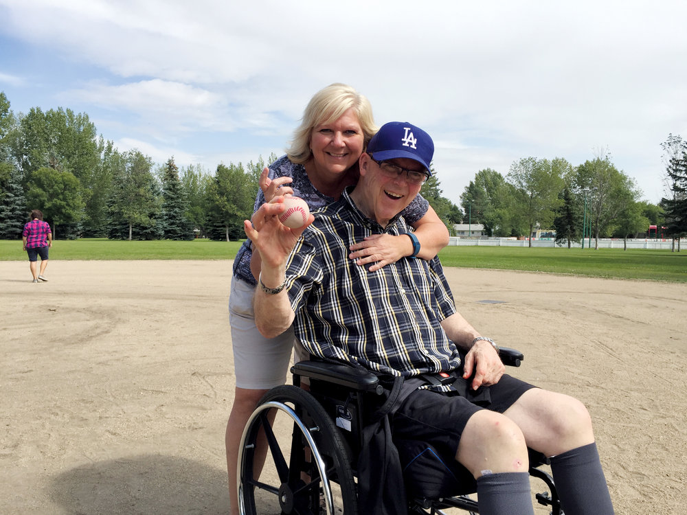 Colleen Pylypow, Sherbrooke's Manager of Volunteers and Global Events, and resident Malcolm Gilbert enjoying a game of baseball. Photo courtesy of Sherbrooke Community Centre.