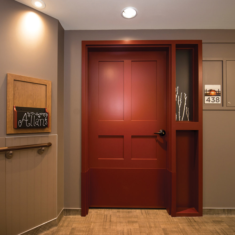Every bedroom door is designed differently — colours and panels differ and door handles are unique. This helps residents identify which door is theirs.