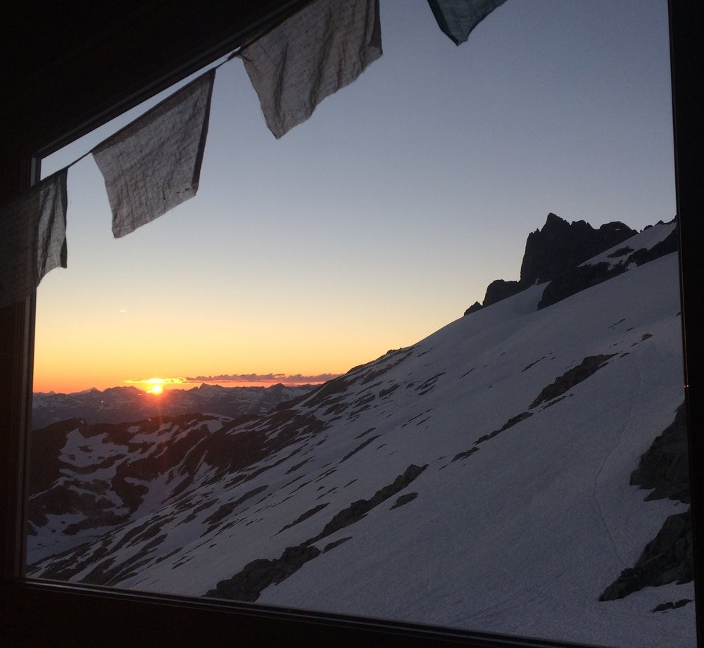 Sunset view from a window of the Haberl Hut