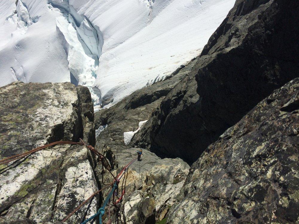 Rapelling off the summit of Mt. Tantalus
