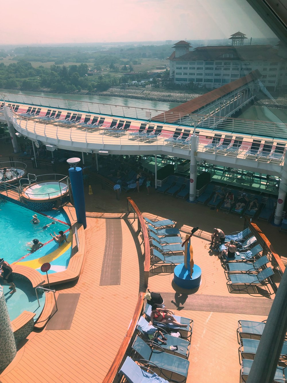 View of Port Klang  and the pool deck from the High Notes lounge up top.