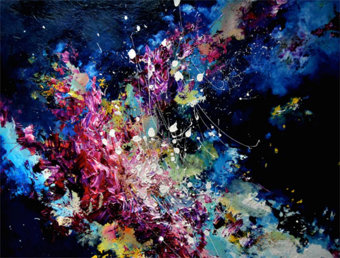 Melissa McCracken, who has music-to-color synesthesia, paints as she listens to music. -