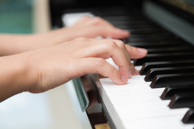 close-up-of-hands-playing-piano_1232-354.jpg