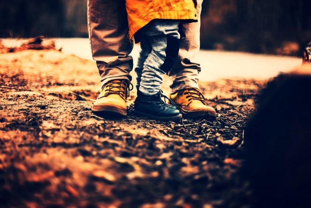 Dad and kid feet.jpeg