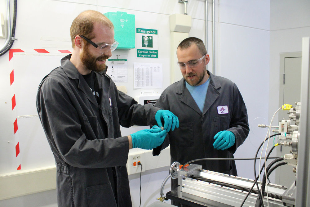 SGM Support Scientist Zachary Arthur and Graham Leverick discussing the best way to load samples into the beamline for an experiment that will hopefully help understand the charge and discharge process in lithium oxygen batteries.