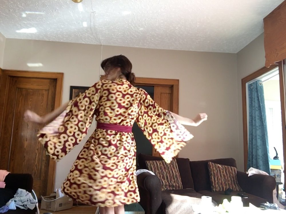 Victoria twirling in robe