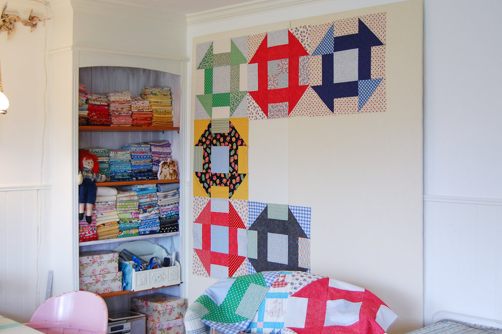 Primary Colors Supersize Churn Dash Quilt Assembly via www.helloquilting.com