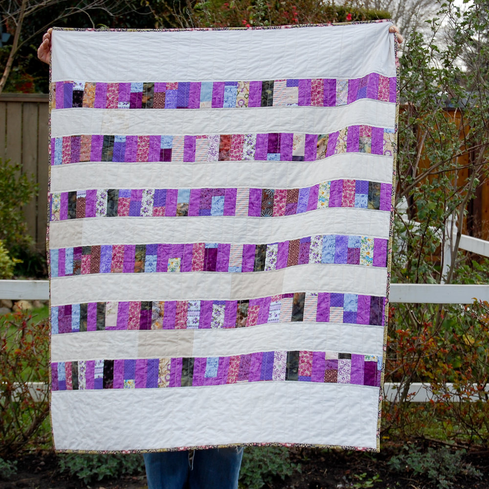Purple Auntie's Quilt Finished via www.helloquilting.com