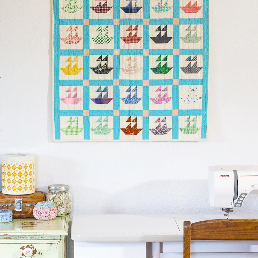 Mini Boat Reproduction Quilt in Sewing Area via www.helloquilting.com