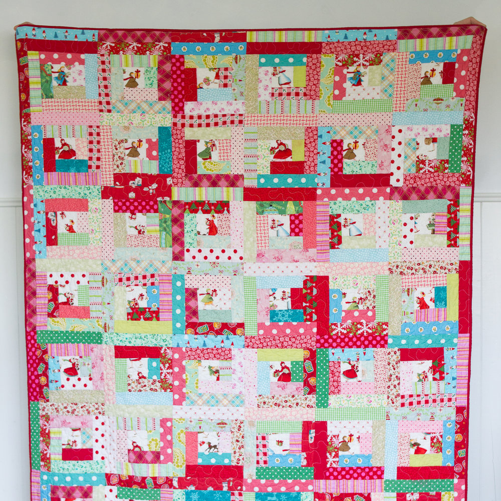 Scrappy Log Cabin Christmas Quilt Finished Flat via www.helloquilting.com