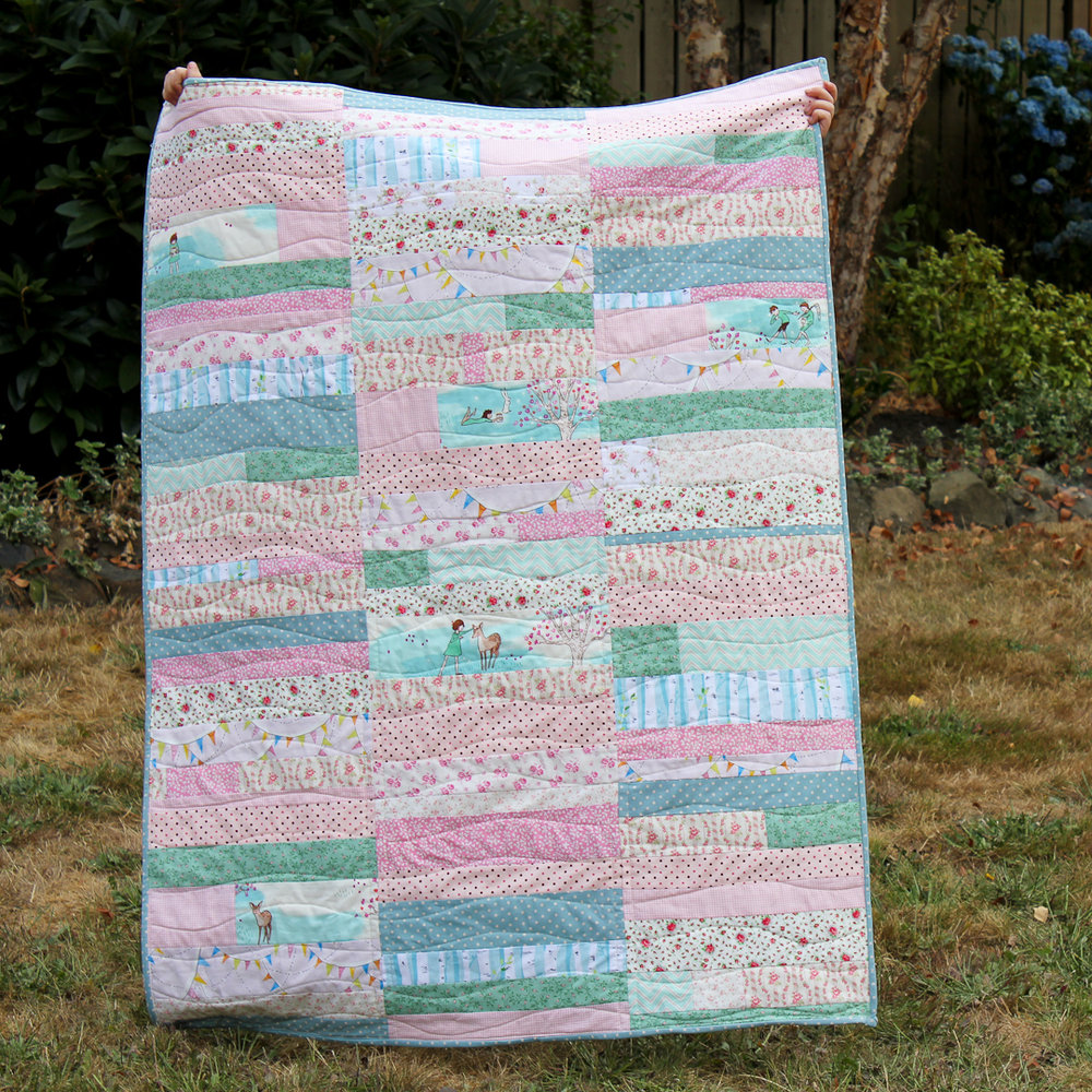 Sweet Scrappy Stripe Block Baby Quilt Finished via www.helloquilting.com