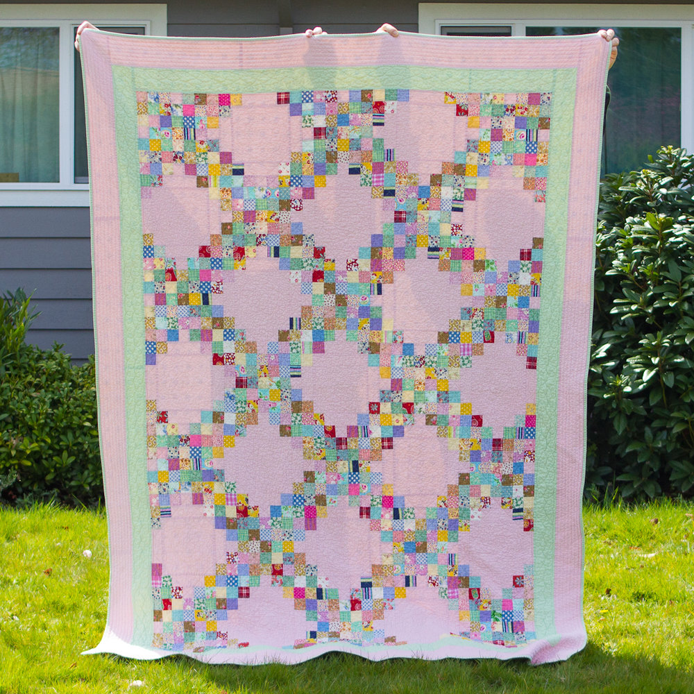 Vintage-Inspired Pink Triple Irish Chain Quilt Finished via www.helloquilting.com