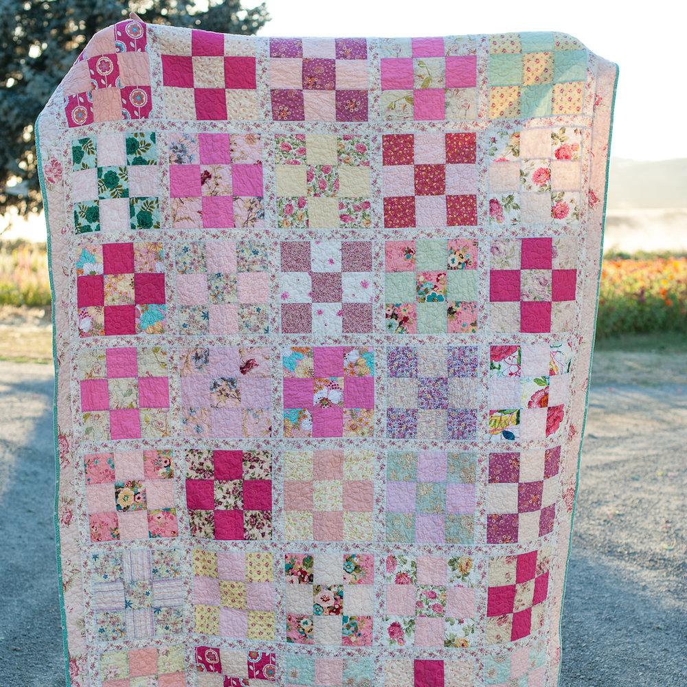 Pinksplosion Checkered Nine-Patch Quilt Finished via www.helloquilting.com