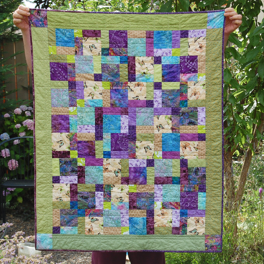 Green Disappearing Nine-Patch Baby Quilt Finished via www.helloquilting.com