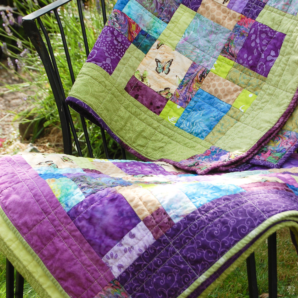 Green & Purple Twin Disappearing Nine-Patch Baby Quilts Finished via www.helloquilting.com