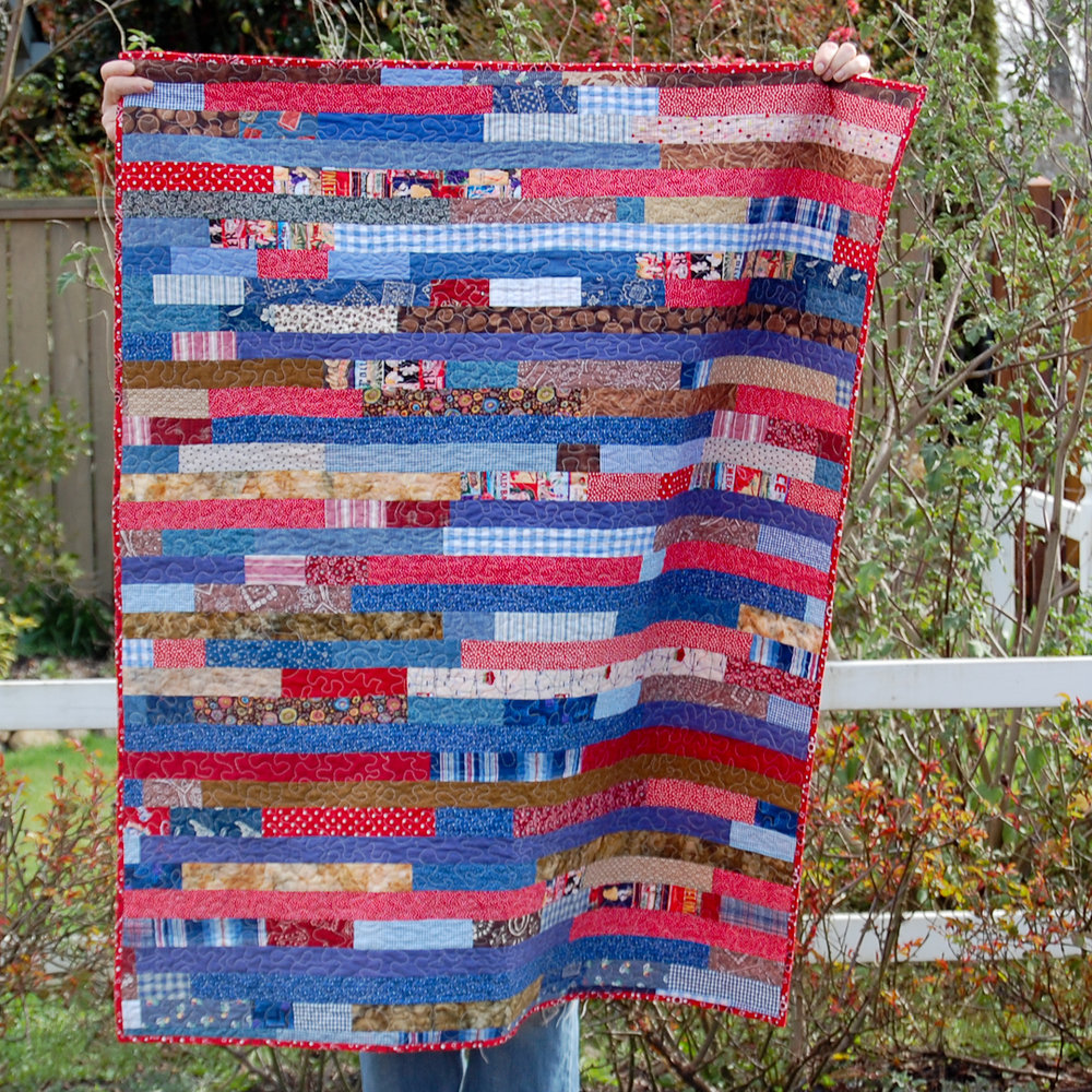 Blue & Red Uncle's Quilt Finished via www.helloquilting.com