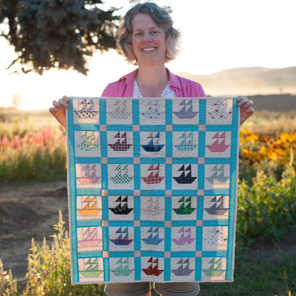 Angela Guzzo from Hello, Quilting! with her Miniature Reproduction Boat Quilt