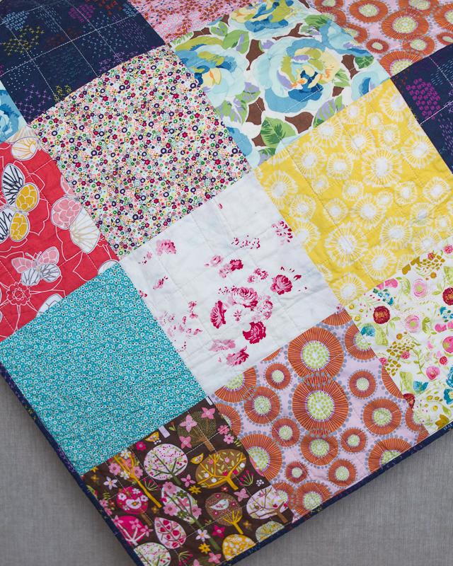 Boho Squares Baby Quilt: Yellow, Pink & Blue Corner via www.helloquilting.com