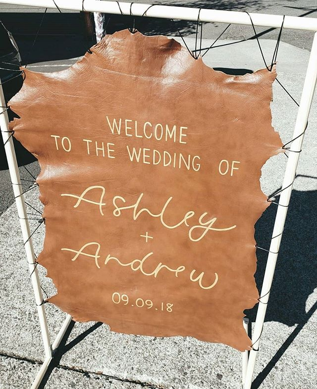 Had so much fun building + crafting this custom leather welcome sign for Ashley + Andrew. The inspiration was a hanging sign, but ours needed to be portable - luckily we were still able to achieve the floating look with leather twine + some artful weaving. To complete the look, we did the lettering in a gold fabric paint, which added a nice metallic pop against the cognac leather.  #weddingstationery #dayofdesign #modernweddings #portlandweddings #pnwweddings #oregonweddings #portlandbride #brideandgroom #minimaldesign #lettering #moderncalligraphy #welcomesign
