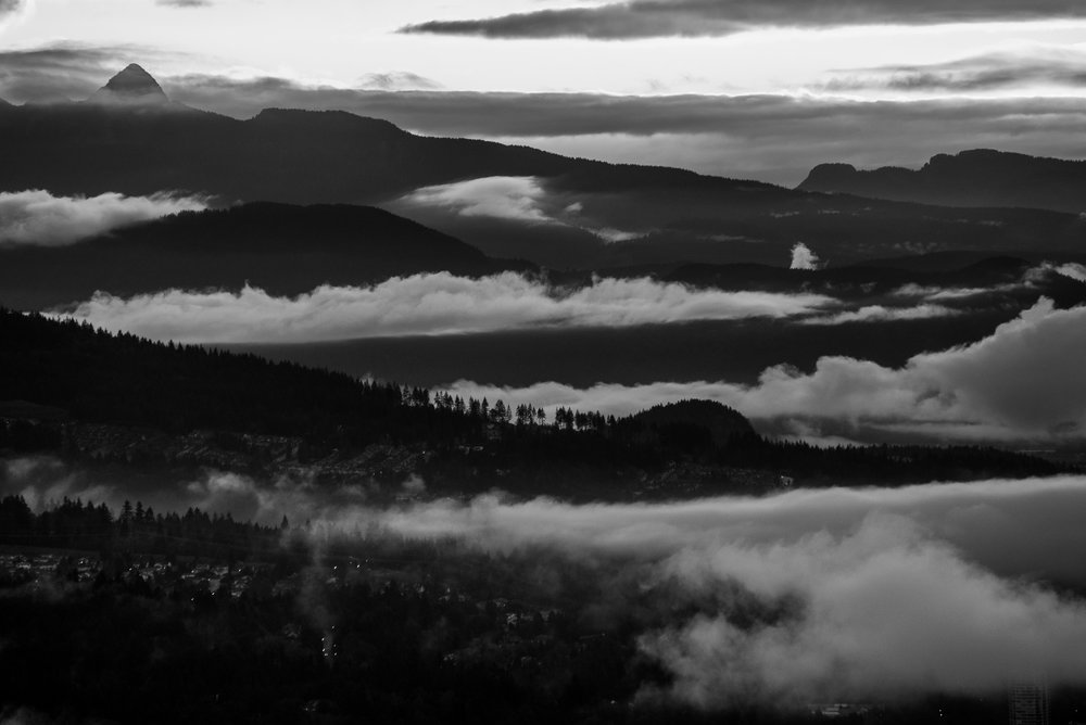 Port Moody and Coquitlam gets patches of fog as photographed from a mountain in Burnaby. Photo: Kristine Nyborg / Wild Blueberry Photography
