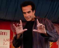 David Copperfield holding a magical pose