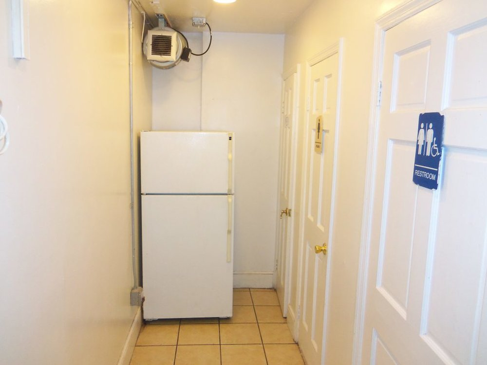 Back Hallway with Refrigerator and Restrooms