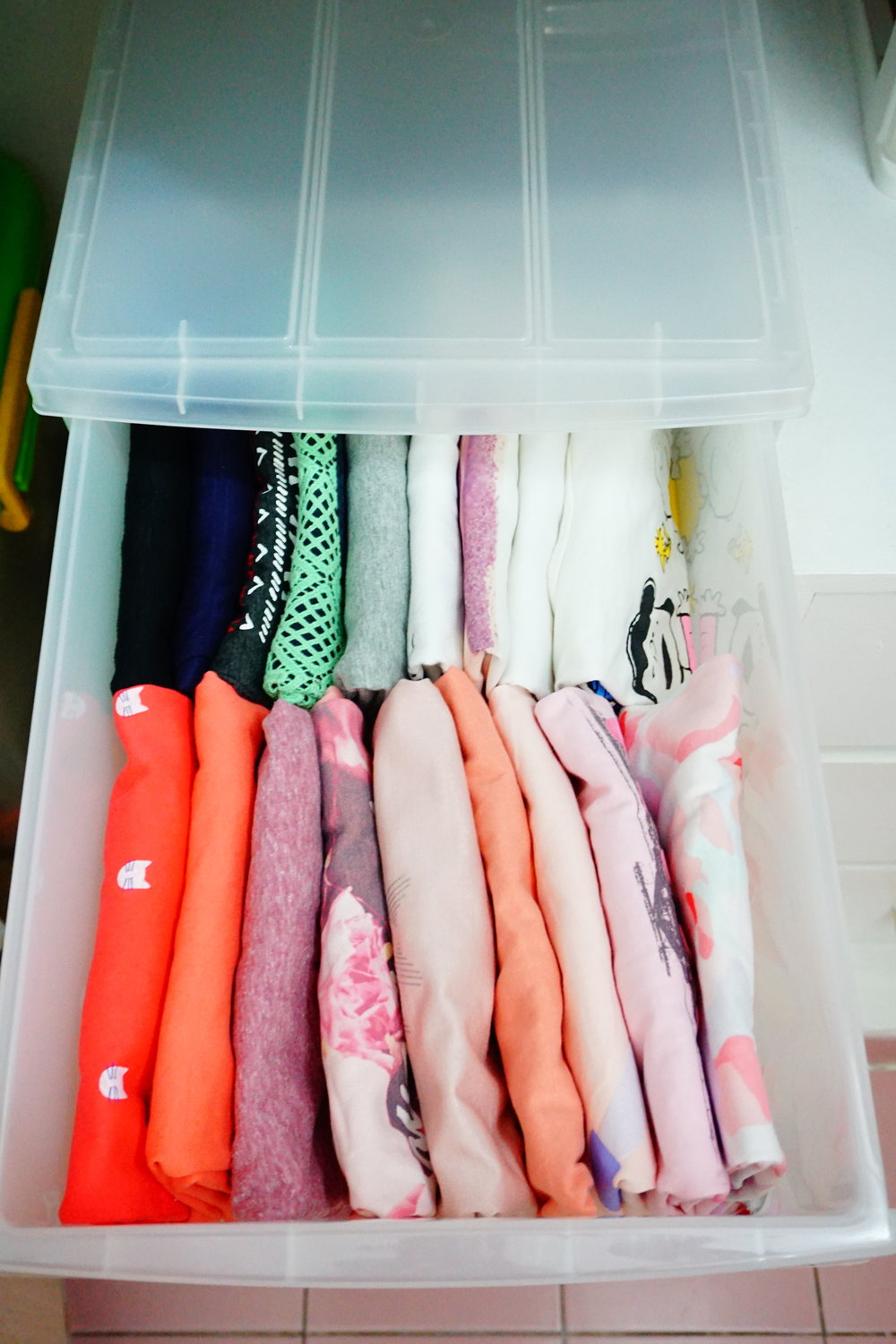 Konmari Method of Storing Shirts - Fold shirts into rectangle, file vertically and fill your drawer 90% full.