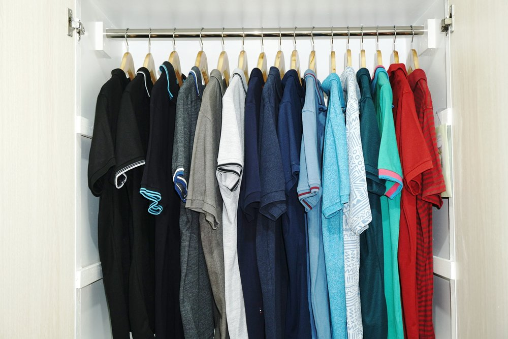 My husband's closet upgraded with wooden hangers