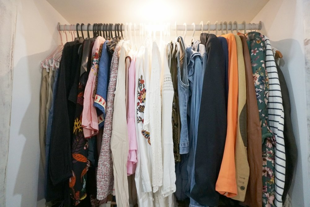 AFTER - hanging clothes arranged properly