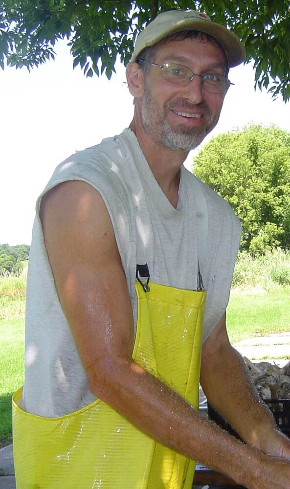 John washing garlic cropped.jpg